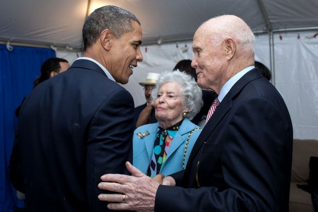 President Barack Obama talks with former Senator John Glenn and wife Annie on the campus of Ohio State University in Columbus, Ohio, Oct. 17, 2010.