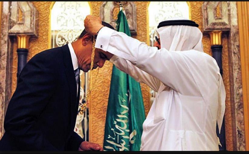 President Obama receives Saudi honor from King Aziz June 3, 2009 (AP Photo)
