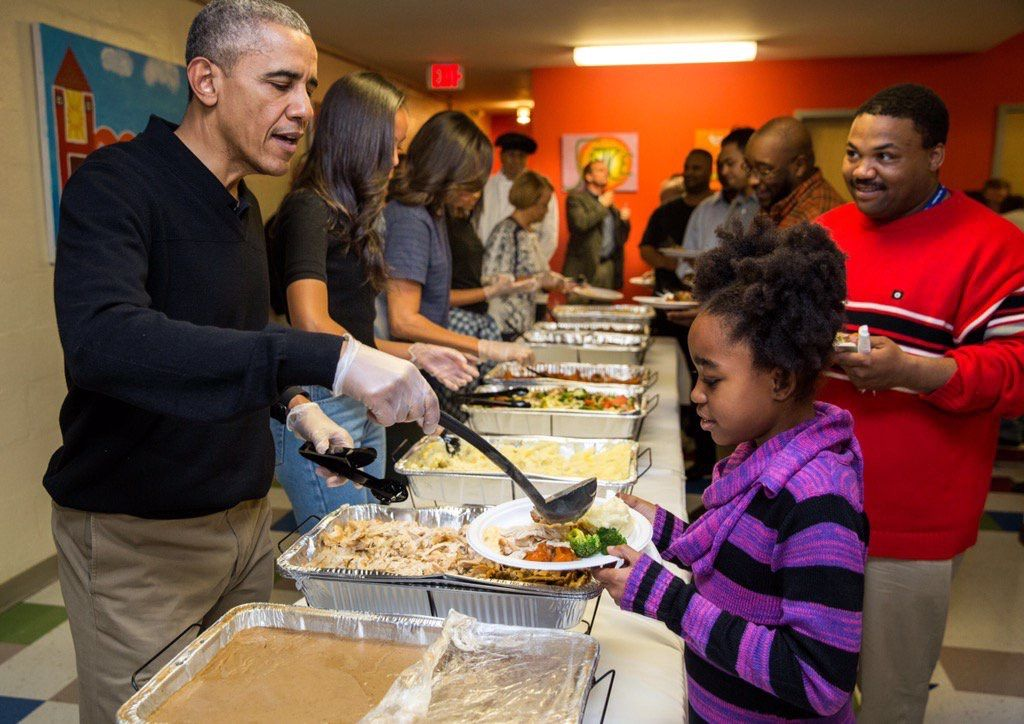 President Obama 2015 doling out turkey