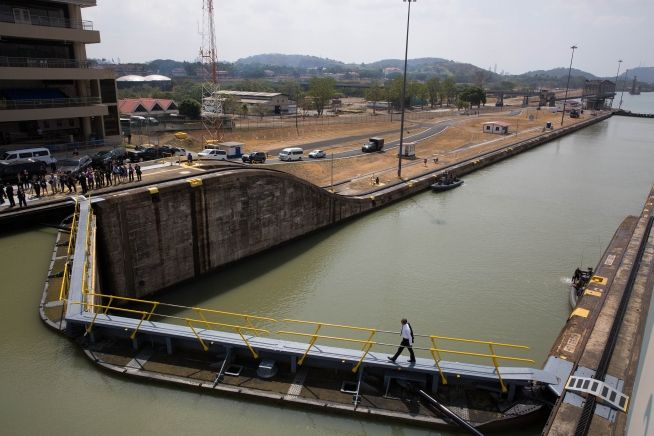 President Obama walks back across a lock after touring the Control Tower at the Panama Canal Miraflores Locks in Ancon, Panama, April 10, 2015