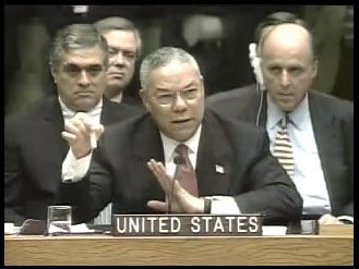 Secretary of State Colin Powell, flanked by CIA Director George Tenant and UN Ambasaador John Negroponte, at UN