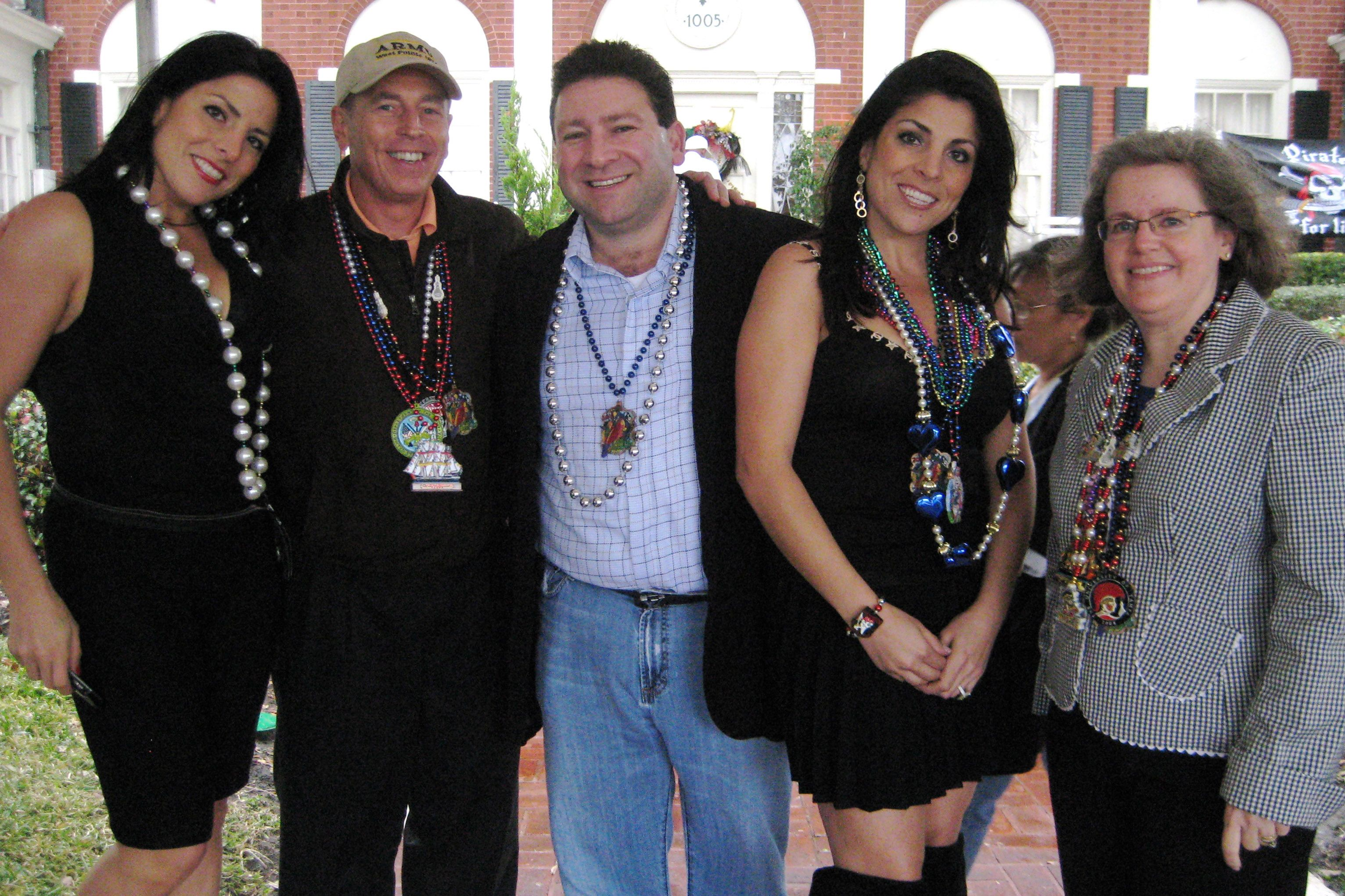 From left, Natalie Kwawam, David Petraeus, Scott Kelley, Jill Kelley, Holly Petraeus in 2010
