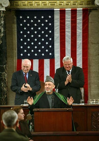 Hamid Karzai speakers to Congress in 2004 with VP Cheney and Speaker Hastert (wikimedia commons)