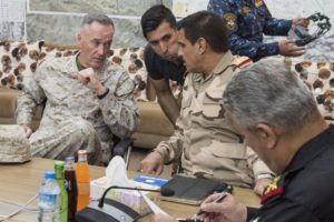Marine Corps Gen. Joe Dunford, chairman of the Joint Chiefs of Staff, meets with members of the coalition at a forward operating base near Qayyarah West, Iraq, April 4, 2017. (DoD Photo