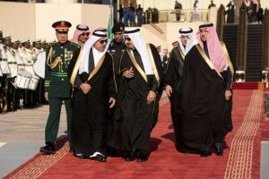 King Salman of Saudi Arabia with his entourage prepare to greet President and Mrs. Obama in Riyadh Jan. 27, 2015 (White House photo)