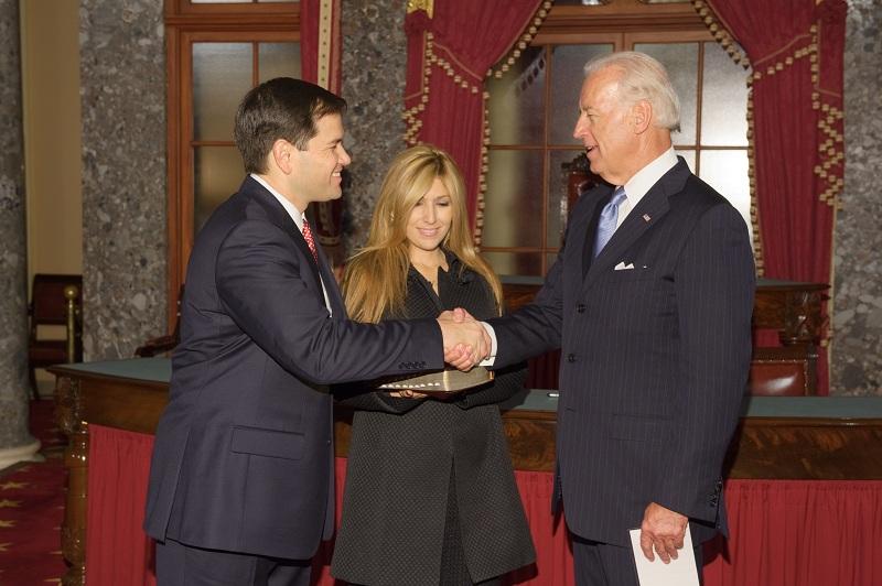 Vice President Joe Biden swears in GOP Florida GOP Senator Marco Rubio as Rubio's wife Jeanette looks on