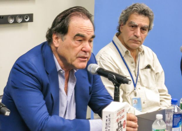 Film Director Oliver Stone, Wall Street Journal United Nations Reporter Joe Lauria (James Reinl Photo for Middle East Eye)