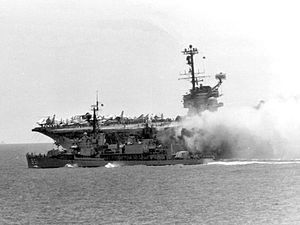 USS Forrestal Fire 1967; USS Forrestal on fire, the worst US carrier fire since WWII; USS Rupertus (DD-851) maneuvers to within 20 ft (6 m) to use fire hoses