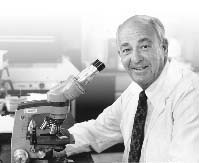 Dr. Cyril H. Wecht in lab
