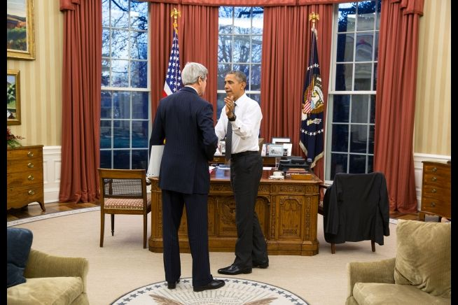 President Obama greets Secretary of State John Kerry Dec. 16, 2015