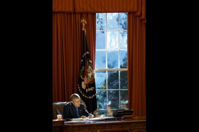 President Obama Working at desk Oct. 2015