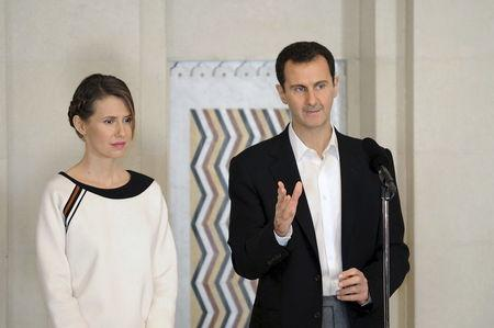 Syrian President Bashar Al-Assad with wife Asma at ceremony for deceased soldiers March 21, 2016 SANA Photo