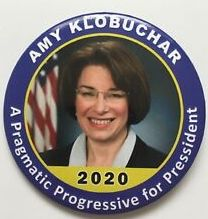 amy klobucher button cropped