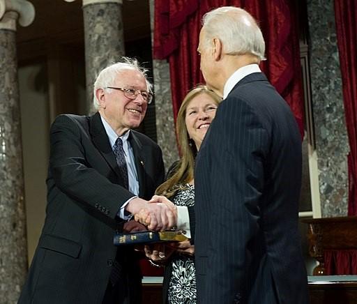Vice President Joe Biden congratulates newly sworn U.S. Sen. Bernie Sanders of Vermontin 2013 as Janes Sanders looks on (Senate photo). 2013 senate photo Custom