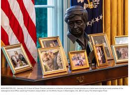 President Biden's new Oval Office, with bust (at center) of the late migrant farm worker labor organizer Cesar Chavez at rear of photos.