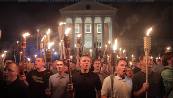 White nationalists march in a Charlottesville torchlight parade chanting