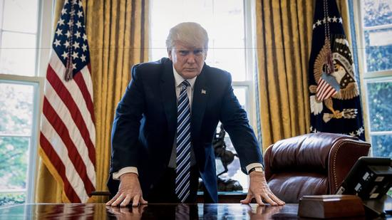 donald trump oval office hands on desk