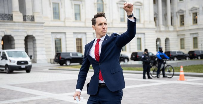 Sen. Josh Hawley, a first-term Missouri Republican, gives a fist salute to the pro-Trump mob outside the U.S. Capitol on Jan. 6, 2021 (photo by Francis Chung).