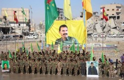 Kurds with banner of Abdullah Ocalan (PKK rally in Raqqa on Oct. 20, 2017)