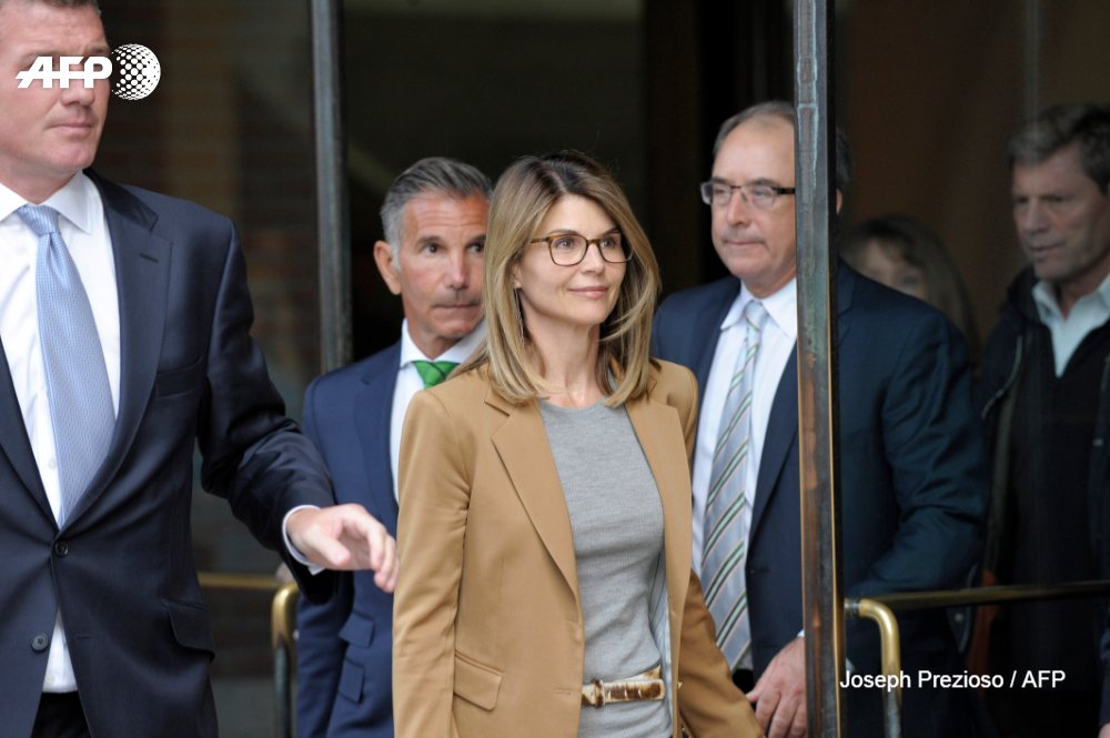Actress Lori Loughlin and her husband and co-defendant Mossimo Giannulli (file photo via Joseph Prezioso and Agence France-Presse)
