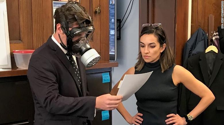 Congressman Matt Gaetz (R-FL), shown at left above, mocked coronavirus prevention measures last year by wearing a gas mask last year on Capitol Hill.