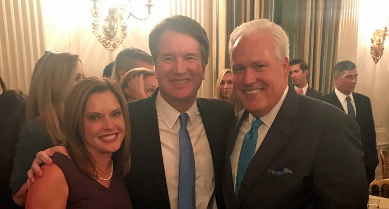White House Advisor Mercedes Schlapp and her husband, prominent attorney and Trump defender Matt Schlapp flank U.S. Supreme Court Justice Brett Kavanaugh