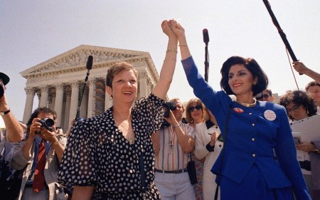 Norma McCorvey, center left, raises arm in triumph with her attorney Gloria Allred following 1973 Roe v. Wade decision, as portrayed in new FX documentary