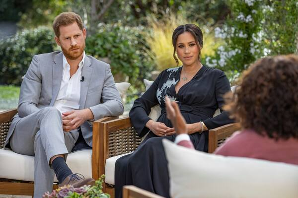 Britain's Prince Harry, his wife Meghan, center, interviewed by Oprah Winfrey for a broadcast airing on March 7, 2021 (screenshot).