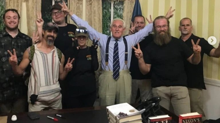 Trump advisor and Jan. 6 insurrection participant Roger Stone poses at center with leaders of the Oath Keepers.