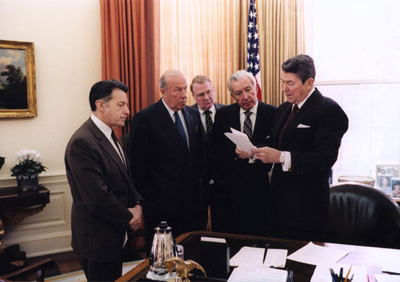 ronald reagan and aides caspar weinberger george schultz ed meese donald reganon Nov 25 1986 before irgan contra press conference