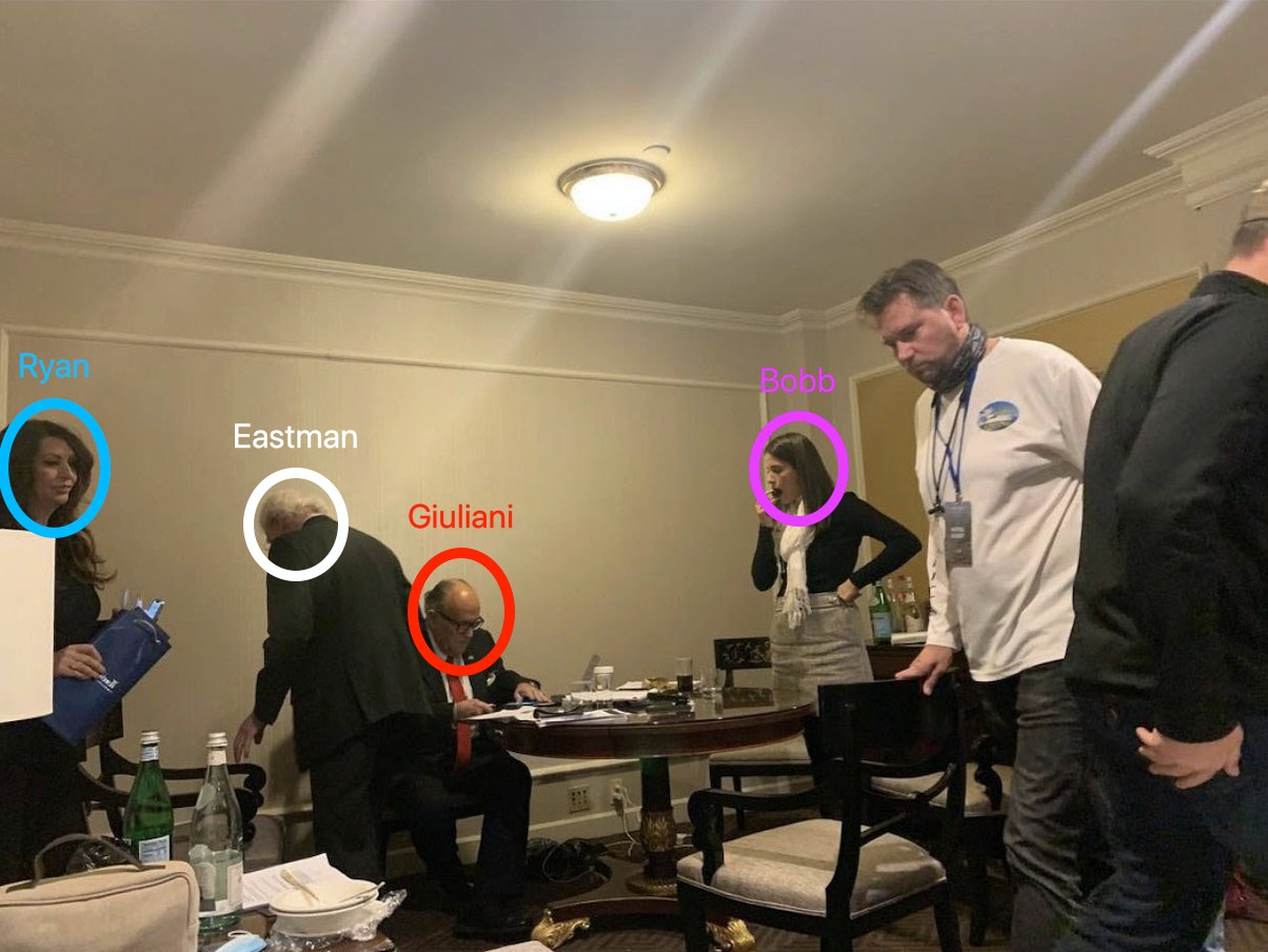 Trump attorney and former Justice Department Deputy Attorney Gen. Rudy Giuliani, his colleague and significant other Maria Ryan, and One America Network White House correspondent Christina Bogbb are shown working in a Willard Hotel