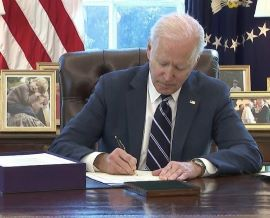 joe biden signs resized relief bill