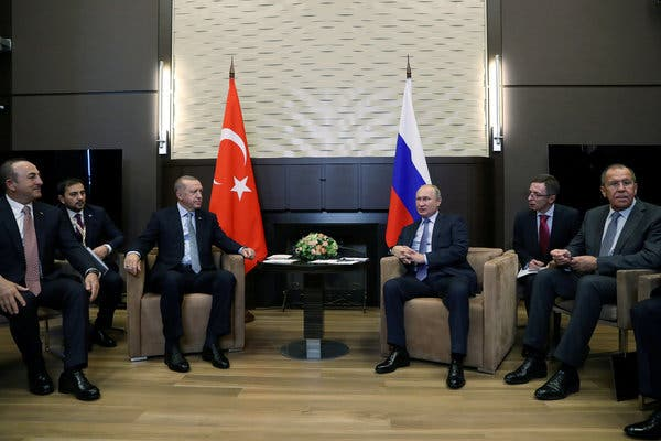 Russian President Vladimir Putin, at right, center, with Turkish President Recept Tayyip Erdogan at Sochi in Russia on Oct. 22, 2019 (Turkish presidential press office photo).