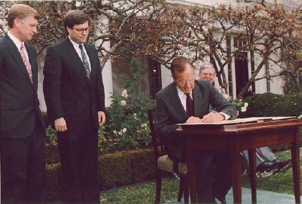 William Barr, President George H.W. Bush and Vice President Dan Quayle as Bush signs civil rights commission reauthorization act rose garden