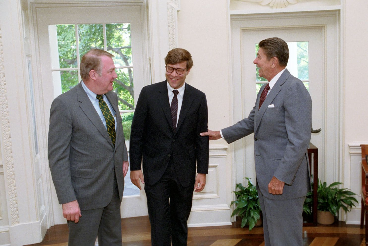 President Ronald Reagan, right, and Attorney General Edwin Meese, left, greeted in a White House 1983 meeting future Attorney General William P. Barr, a former CIA staffer who was then deputy assistant director of legal police at the Justice Department (Reagan Library photo)
