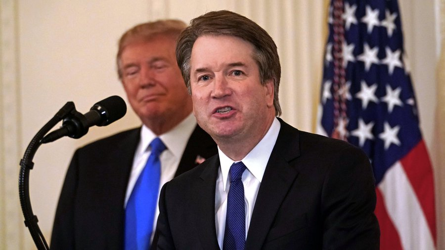 Donald Trump announces the nomination of Brett Kavanaugh, right, to join the U.S. Supreme Court (New York Times photo by Doug Mills on July 9, 2018).