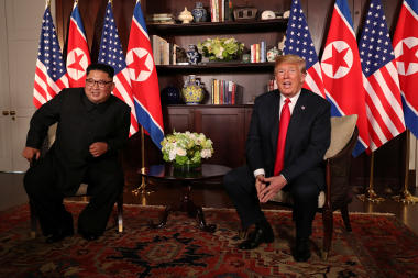 Donald Trump and Kim Il Jong at meeting on June 12, 2018