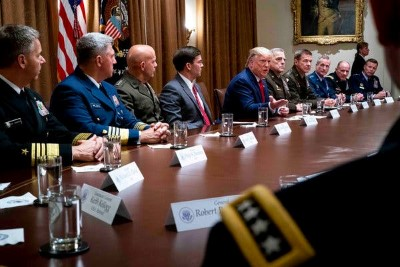 Donald Trump, center, with Defense Secretary Mark Esper and other miliitary leaders at the White House (October 2019 photo for the New York Times by Doug Mills)