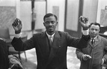 Patrice Lumumba Congo, raising arms in 1960 showing shackles marks